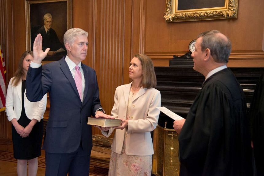 US Chief Justice John Roberts swears in judge Neil Gorsuch during a private ceremony at the Supreme Court in Washington.