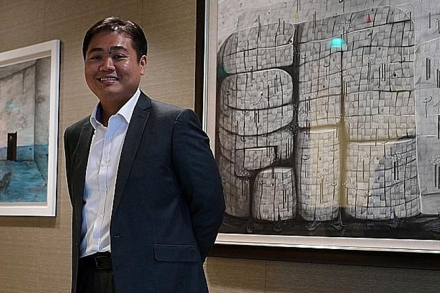 Painter Tang Kok Soo (above), 41, quit his job as an engineer and downgraded to a smaller flat in order to pursue his love for painting.