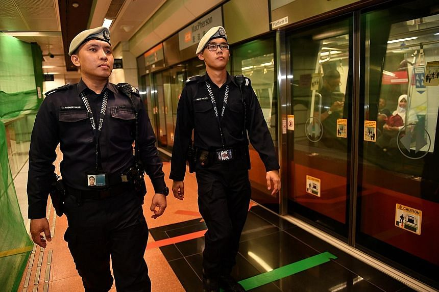 Staff Sergeant Nasron Nasir (far left) and Corporal Muhammad Ruzaini were the first TransCom officers to arrive at Hougang MRT station after an unattended bag was found on its platform.