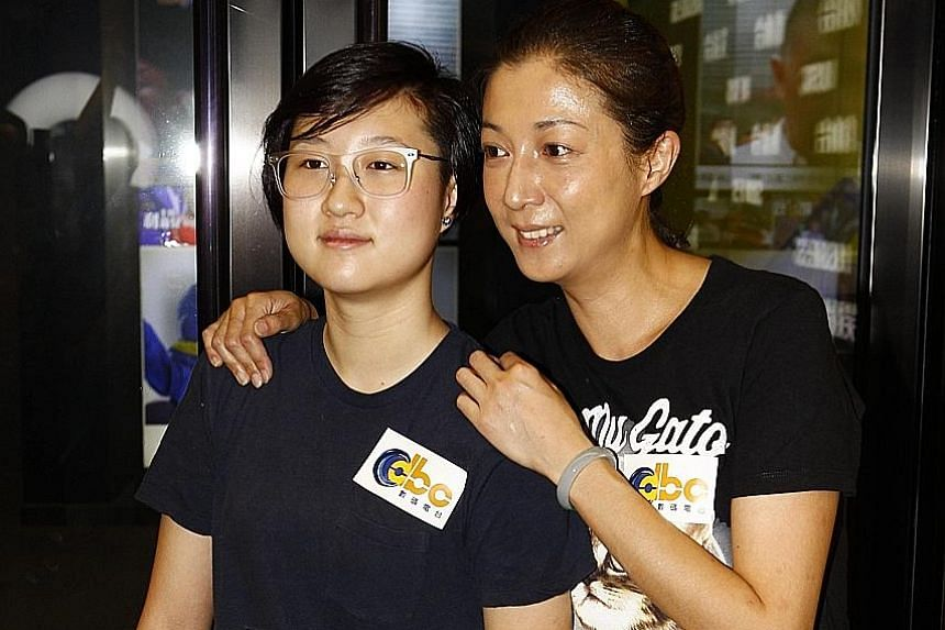 Elaine Ng with daughter Etta (both above) in a file photo.