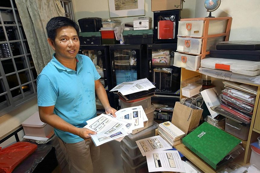 Avid Singapore postage label collector Poh Kian Hwee with his collection at his home in Bukit Merah. He has been collecting labels long enough to see improvements in paper and print quality through multiple generations of SAM kiosks.