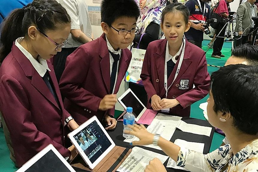 Rosyth School pupils explaining their project to a member of the public at the recent ExCEL Fest. The school's two-part programme comprises a news broadcast and a forum.