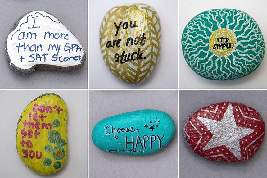 Some of the rocks painted by students at Lexington High School with messages meant to boost spirits and spread calm. The maxims became a visual reminder of a larger, community-wide initiative: to tackle the joy-killing, suicide-inducing performance a