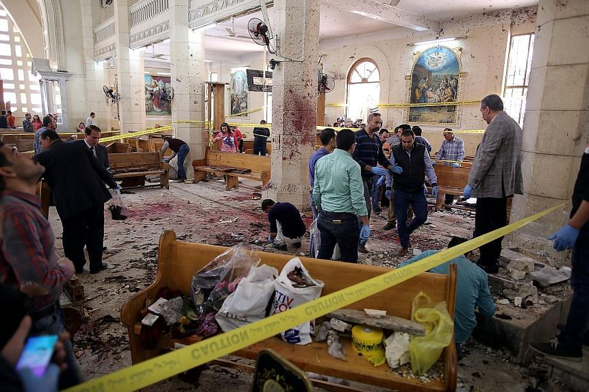 The scene of the first explosion at Mar Girgis church in Tanta, north of Cairo, yesterday. At least 27 people were reported killed in the bombing. A few hours later, a suicide blast took place outside St Mark's Cathedral in Alexandria, the historic s
