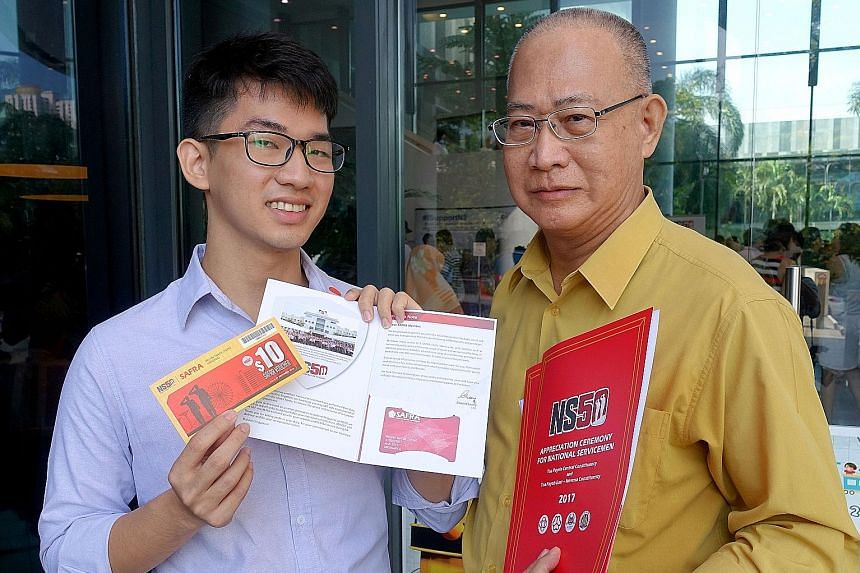 Mr Melvin Tan De Zheng, 26, and his father Dave Tan Jong, 65, were among the 500 national servicemen who received their NS50 packages at ceremonies yesterday. The packages will be given out at 52 ceremonies over these two months, and many others will