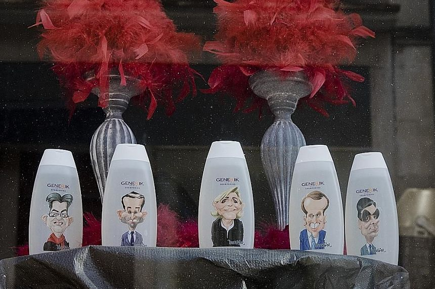 Shampoo bottles displaying caricatures of the candidates on sale at a hair salon in Donzy. For the record, it is Mr Emmanuel Macron's big toothy grin and Mr Francois Fillon's bushy eyebrows that are selling best.
