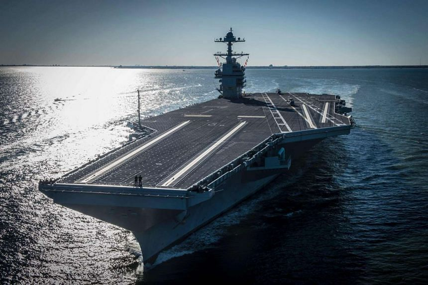 A handout photo from the US Navy shows the USS carrier Gerald R. Ford underway on its own power for the first time on April 8, 2017.