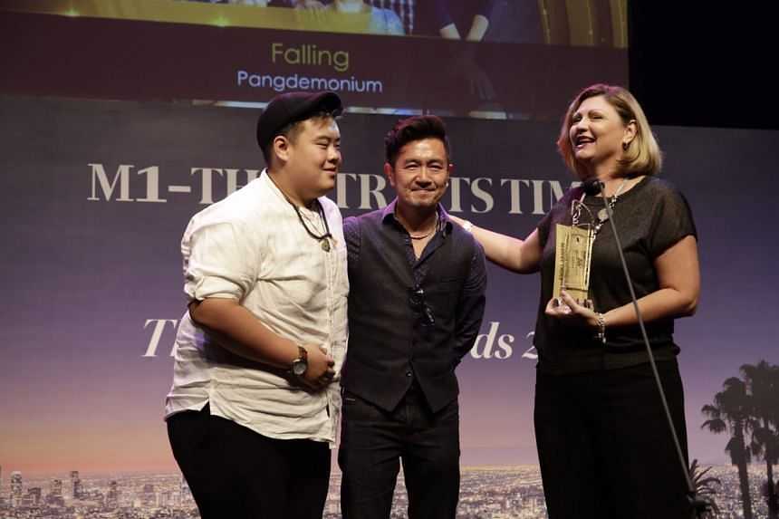 Andrew Marko, Adrian Pang and Tracie Pang accept the readers' choice award for Best Production of the Year for Falling by Pangdemonium.