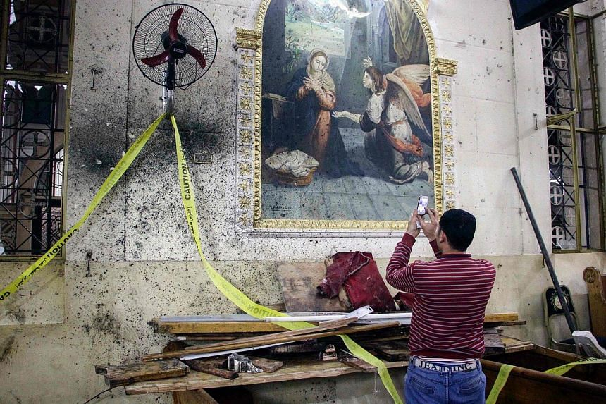 The destruction inside the Mar Girgis Coptic Orthodox Church in the Nile Delta City of Tanta after a bomb blast.
