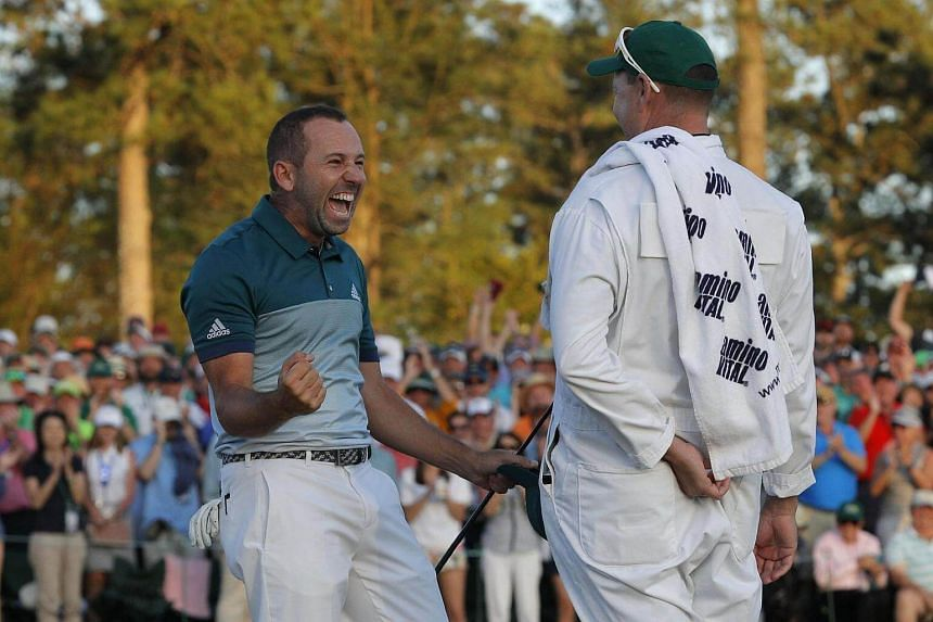 Sergio Garcia of Spain (left) celebrates winning the Masters with caddie Glenn Murray during a playoff against Justin Rose of England in the final round of the 2017 Masters golf tournament, on April 9, 2017.