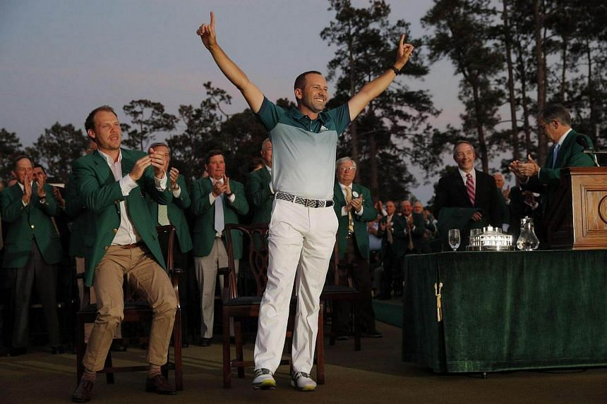 Sergio Garcia of Spain celebrating next to the 2016 champion, Danny Willett of England (left), during the green jacket ceremony after Garcia won the 2017 Masters golf tournament, on April 9, 2017.