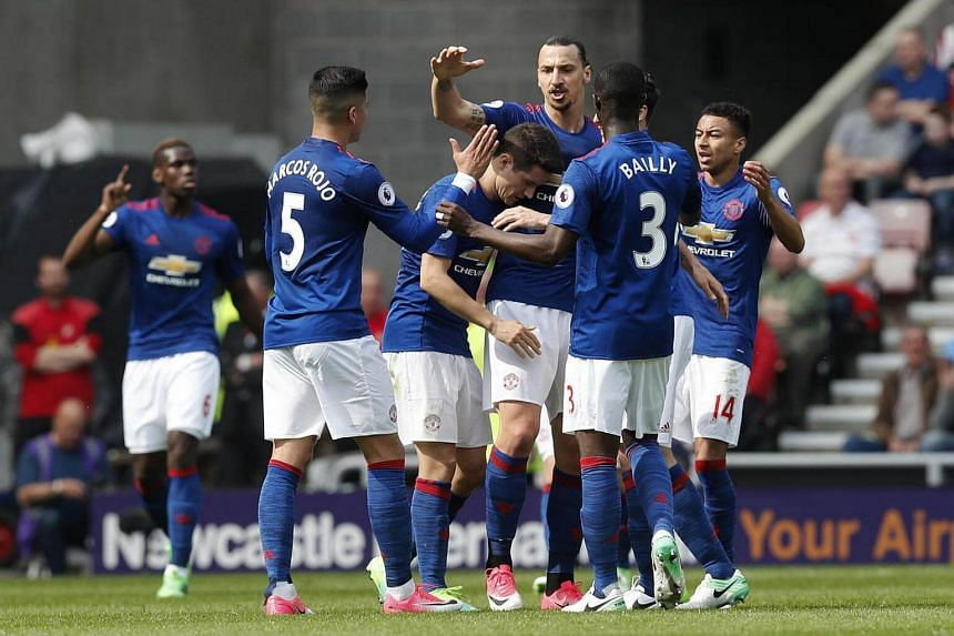 Manchester United's Zlatan Ibrahimovic celebrating after scoring their first goal with teammates.