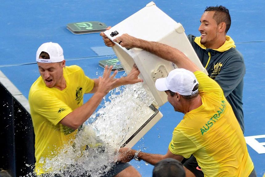 Australia's Nick Kyrgios pours ice over team captain Lleyton Hewitt after Australia defeated the USA in their Davis Cup quarterfinal matches.