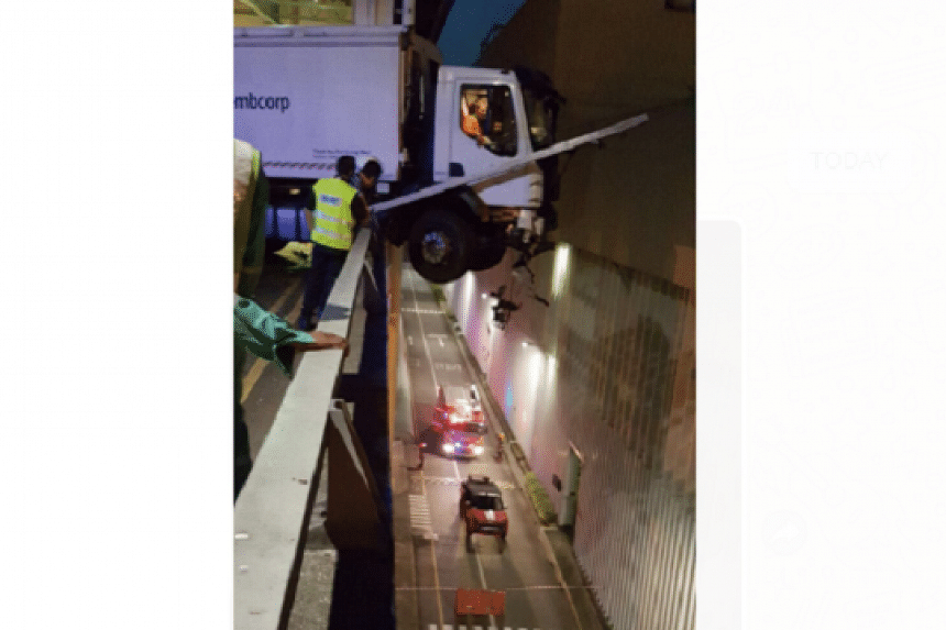 The driver was eventually freed by the Singapore Civil Defence Force with an aerial rescue platform, and was taken to hospital.