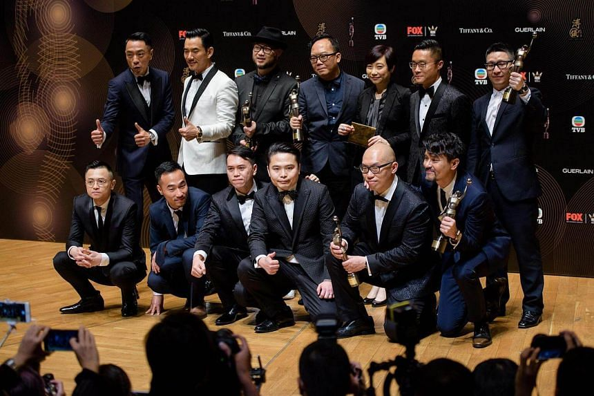 Members of cast and crew of film Trivisa celebrate with their awards, including Best Film and Best Actor, won by Hong Kong actor Gordon Lam (bottom, right) at the Hong Kong Film Awards ceremony, on April 9, 2017.