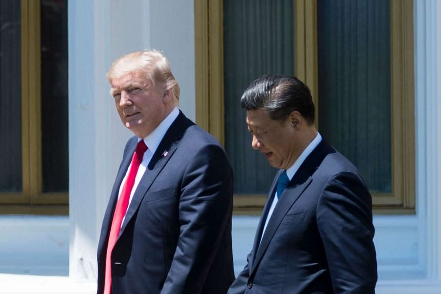 US President Donald Trump (left) and Chinese President Xi Jinping walking together at the Mar-a-Lago estate in West Palm Beach, Florida, on April 7, 2017.