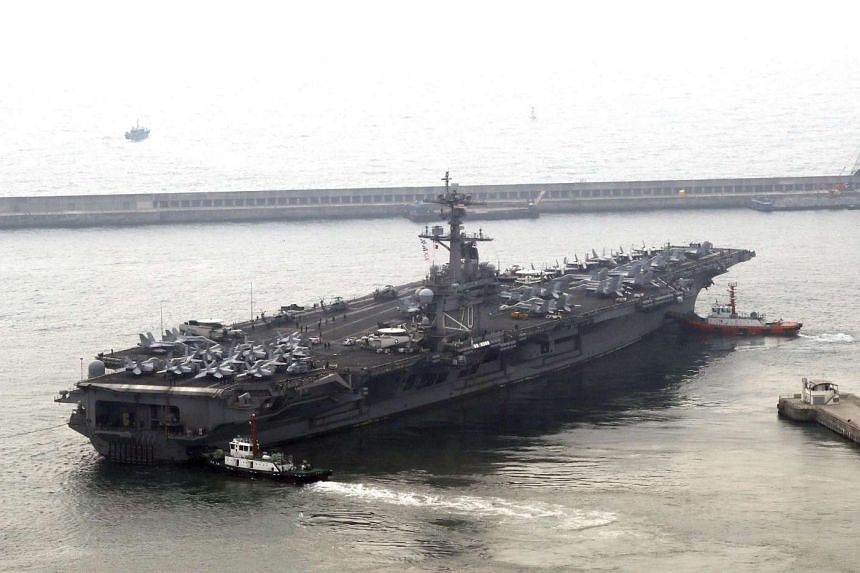 The USS Carl Vinson supercarrier leaving a port in Busan, South Korea, on March 20, 2017.