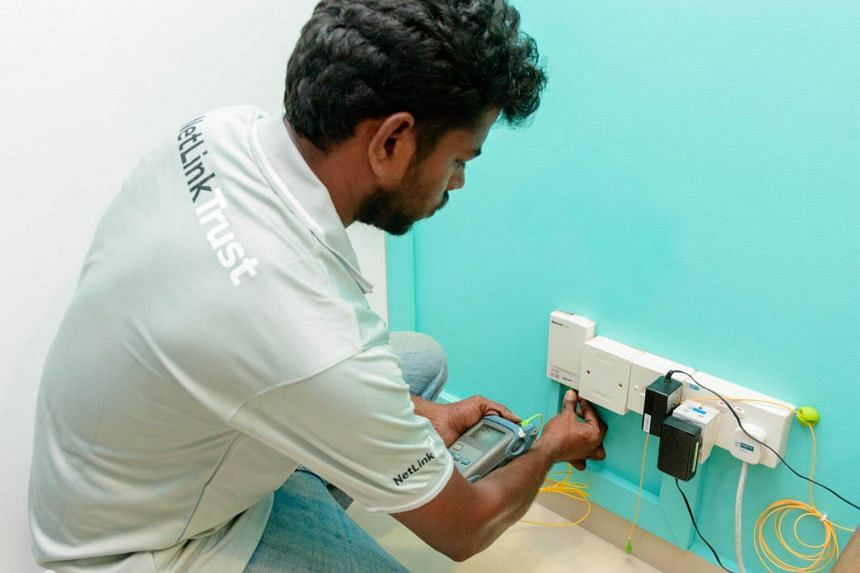 File photo of a NetLink Trust worker working. NetLink Trust services were disrupted by a cut cable, the company reported on April 11, 2017.