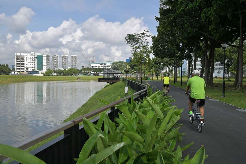 People cycling along the Kallang River.