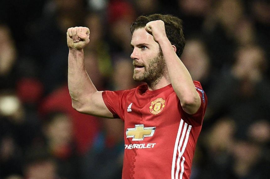 Manchester United's midfielder Juan Mata celebrates scoring the opening goal during the Uefa Europa League round of 16 football match between Manchester United and FC Rostov at Old Trafford stadium in Manchester, England, on March 16, 2017.