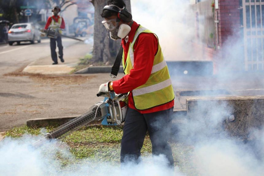NEA officers and Pest Control Operators conducting fumigating operations at Simon Place, after a case of Zika was reported, on March 30, 2017.