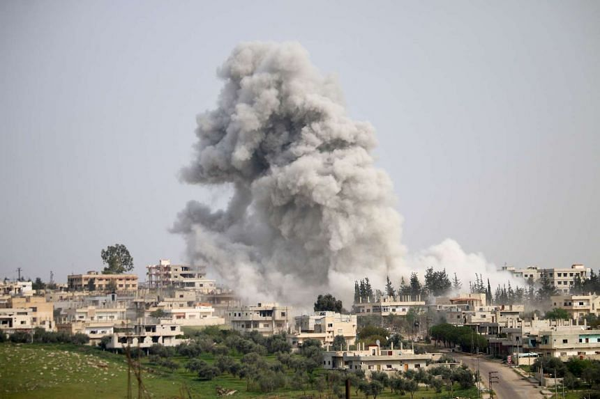 Smoke billows following a reported air strike on a rebel-held area in the southern Syrian city of Daraa, on April 8, 2017.