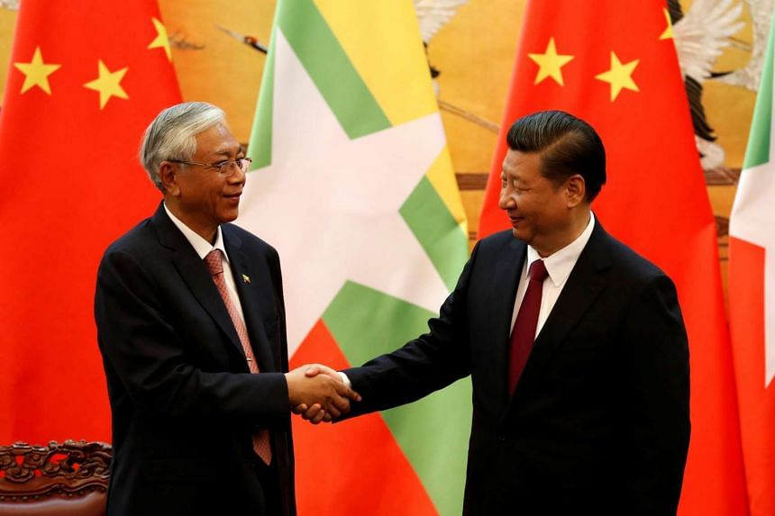 Chinese President Xi Jinping (right) shakes hands with Myanmar's President Htin Kyaw at the Great Hall of People in Beijing, China, on April 10, 2017.