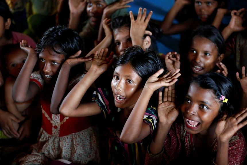 Refugee Rohingya children reciting a poem at a makeshift school at Balukhali Makeshift Refugee Camp in Cox's Bazar, Bangladesh, on April 10, 2017.