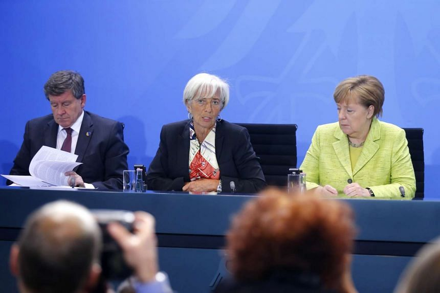 Director-General of the International Labour Organization Guy Ryder (left), Managing Director of the IMF Christine Lagarde (centre) and German Chancellor Angela Merkel attending a news conference following a meeting of the heads of international econ