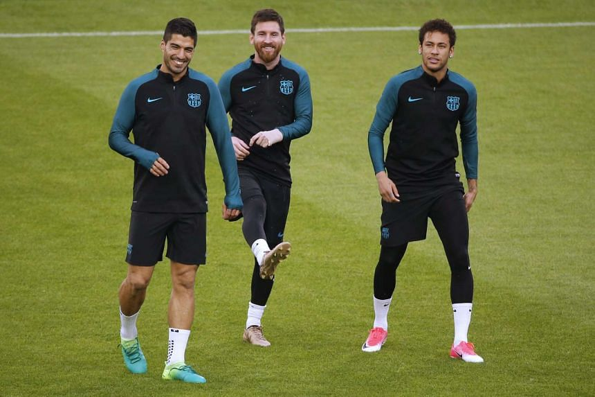 From left: Barcelona footballers Lionel Messi (centre), Luis Suarez and Neymarl take part in a training session on the eve of the UEFA Champions League football match Juventus versus FC Barcelona on April 10, 2017 at the Juventus Stadium in Turin.
