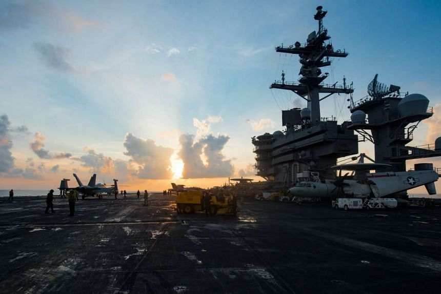 A handout photo from the US Navy shows the aircraft carrier USS Carl Vinson (CVN 70) as it transits the South China Sea, April 8, 2017.