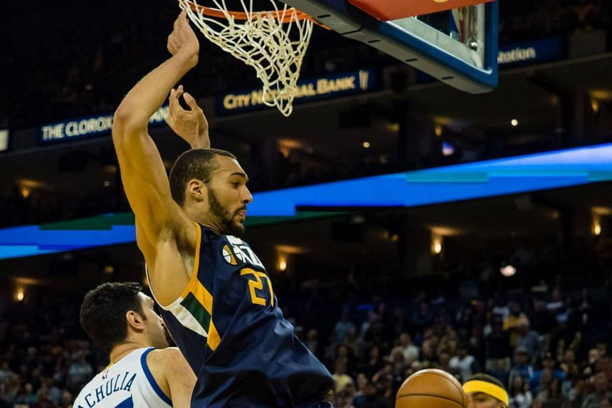 Utah Jazz centre Rudy Gobert dunking the ball against the Golden State Warriors during their NBA game on April 10, 2017.