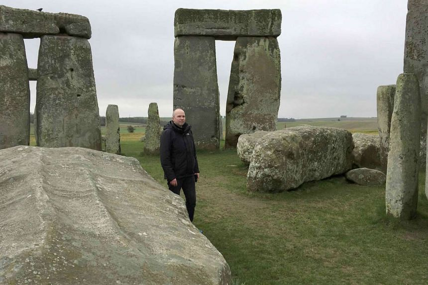 Doctor Rupert Till, music technologist from the University of Huddersfield, poses for a photograph in the stone circle of the ancient monument of Stonehenge, Amesbury, Britain on Feb 22, 2017.