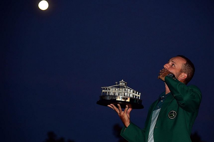 Looking to the skies and blowing a kiss to his late compatriot Seve Ballesteros, Sergio Garcia of Spain celebrates with the Masters Trophy after defeating Justin Rose at the first play-off hole. Garcia was the only player in the 93-man field to shoot