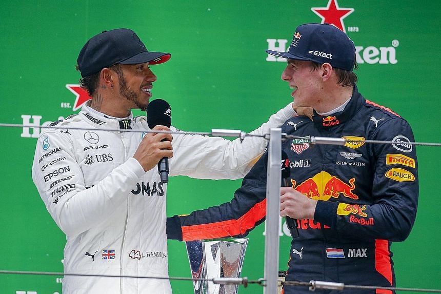"Lewis Hamilton (left) with Max Verstappen on the podium after the Mercedes driver won the Shanghai Grand Prix last Sunday. The Briton called the third-placed Dutchman ""this young guy"" and then, when lightheartedly challenged by Verstappen, quickly am"