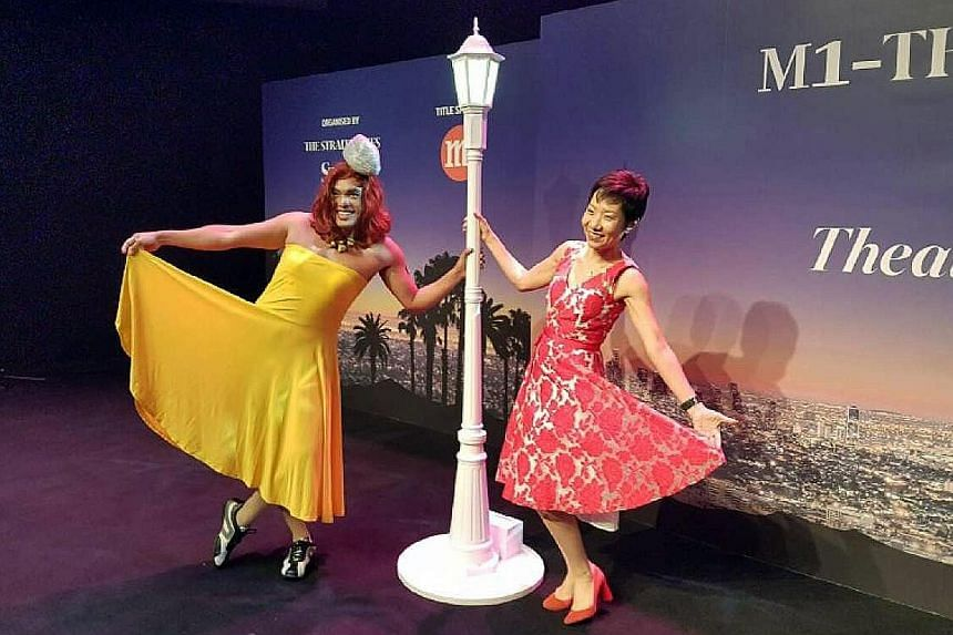Actor Dwayne Lau, who won the Best Dressed prize, and Culture, Community and Youth Minister Grace Fu, the guest of honour at the awards, giving their best La La Land pose at the Esplanade yesterday. At yesterday's Life Theatre Awards were (standing,
