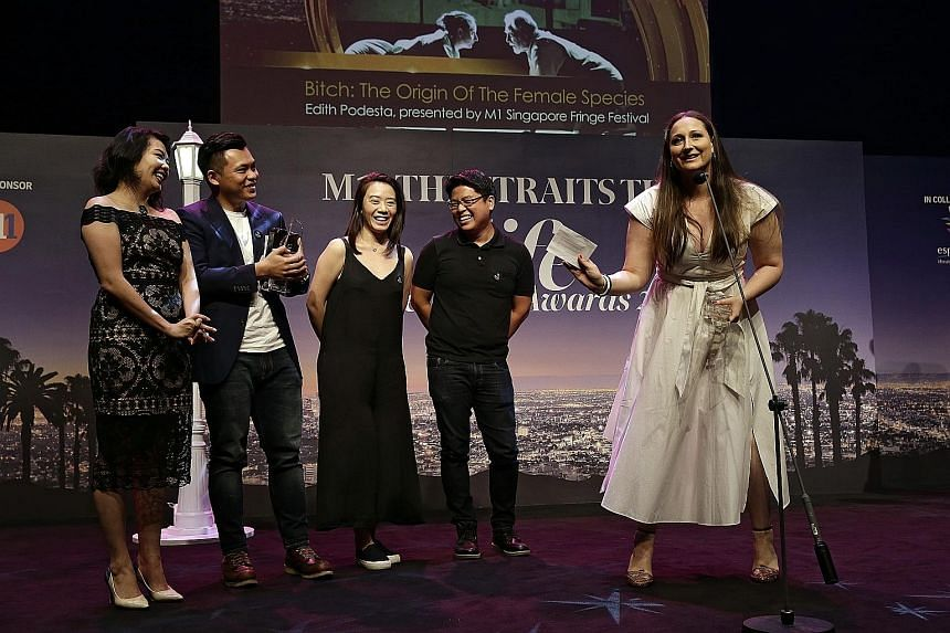 The team behind B*tch: The Origin Of The Female Species, a winner at the M1-The Straits Times Life Theatre Awards - (from left) actress Chanel Ariel Chan, lighting designer Adrian Tan, production/stage manager Mirabel Neo, multimedia designer Brian G