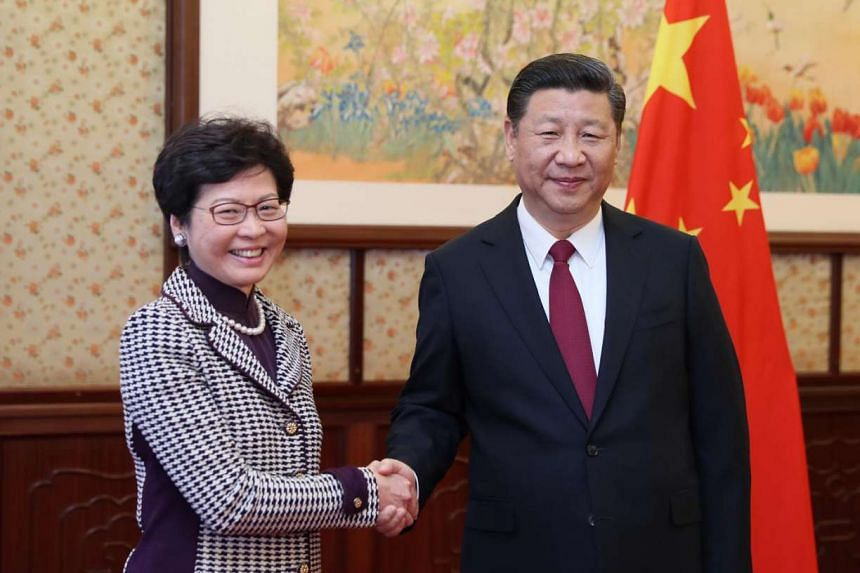 Hong Kong's Chief Executive-elect Carrie Lam meets Chinese President Xi Jinping at the central government's compound in Zhongnanhai, Beijing, on April 11, 2017.