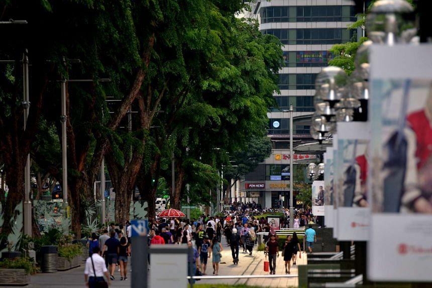 People walking along Orchard Road.