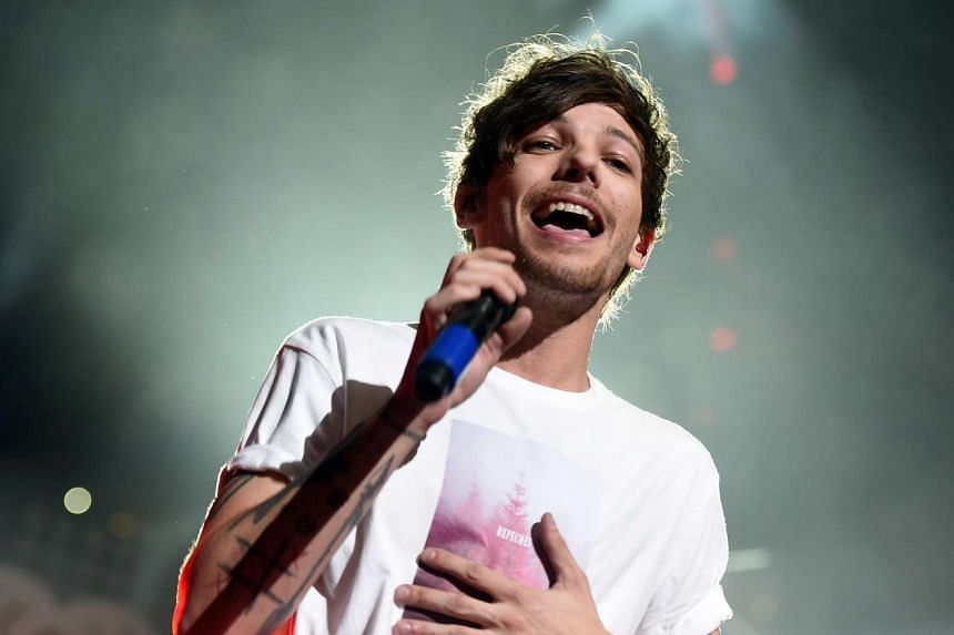 One Direction singer Louis Tomlinson (above) was booked for misdemeanor battery.after the March 3 incident.