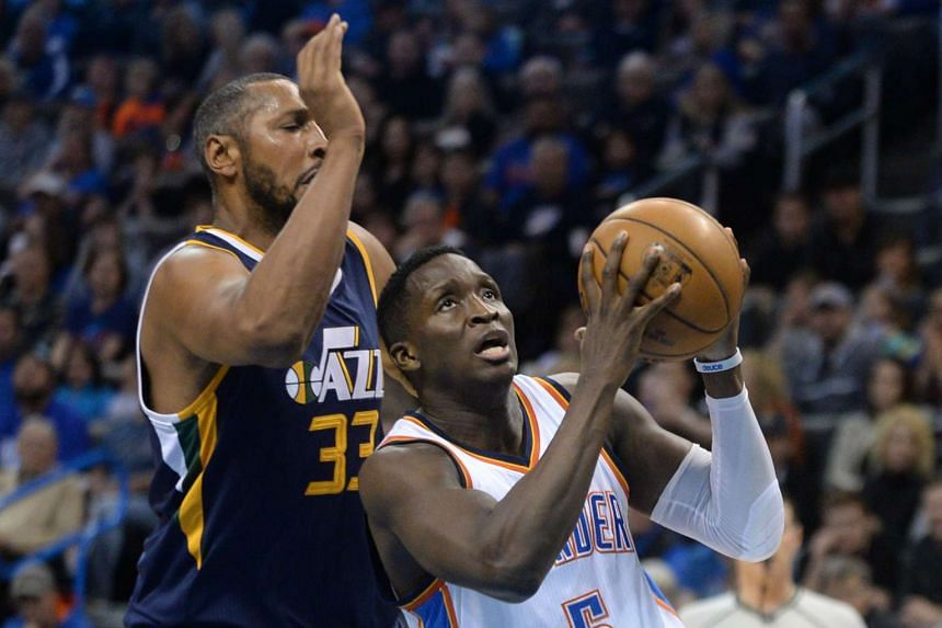 Oklahoma City Thunder's Victor Oladipo (right) drives to the basket in front of Utah Jazz's Boris Diaw in a match on March 11.