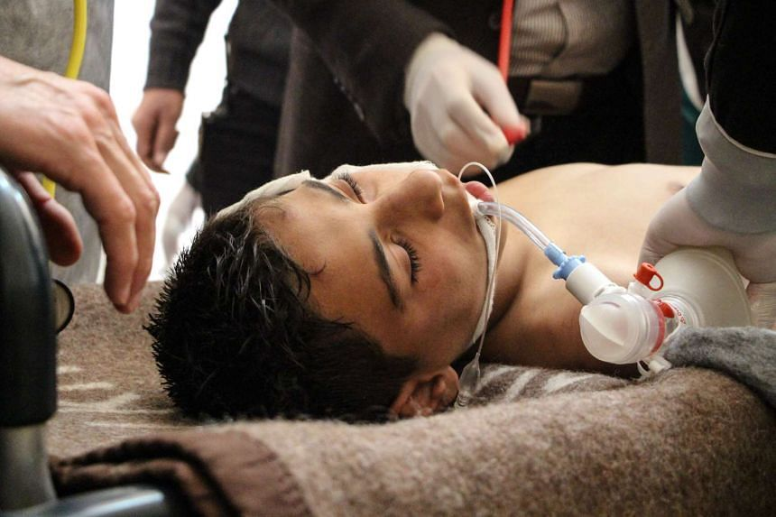 A Syrian victim receives treatment after a chemical attack at a field hospital in Saraqib, Idlib province, April 4, 2017.