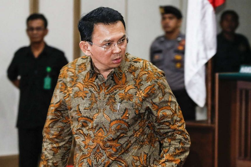"""Jakarta's governor Basuki Tjahaja Purnama popularly known as """"Ahok"""", looks on during his trial at the North Jakarta District Court in Jakarta,  on April 11, 2017."""