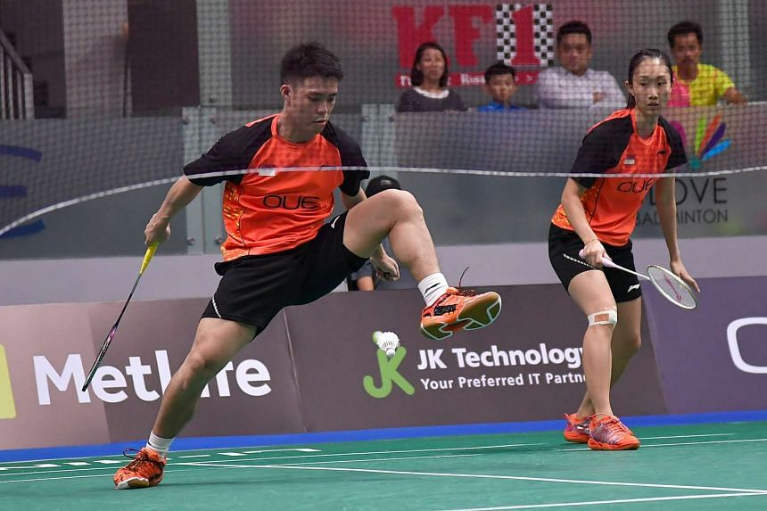 Singapore's Terry Hee and Tan Wei Han in action against Indonesia's mixed double pair at the Opening day of the OUE Singapore Open on April 11, 2017.