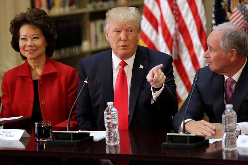 Trump (centre) at a CEO discussion with Transportation Secretary Elaine Chao and Blackstone CEO Stephen Schwarzman, April 11, 2017.