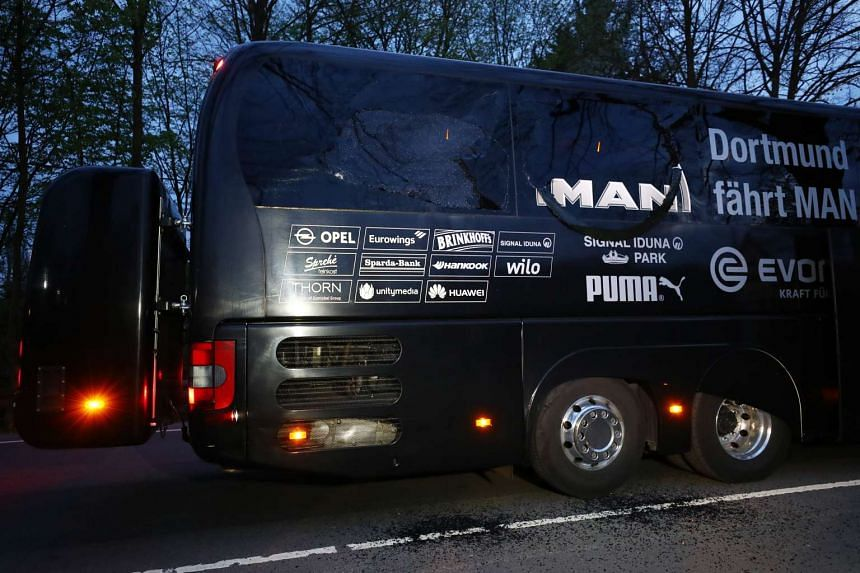 The Borussia Dortmund team bus is seen after the explosion.