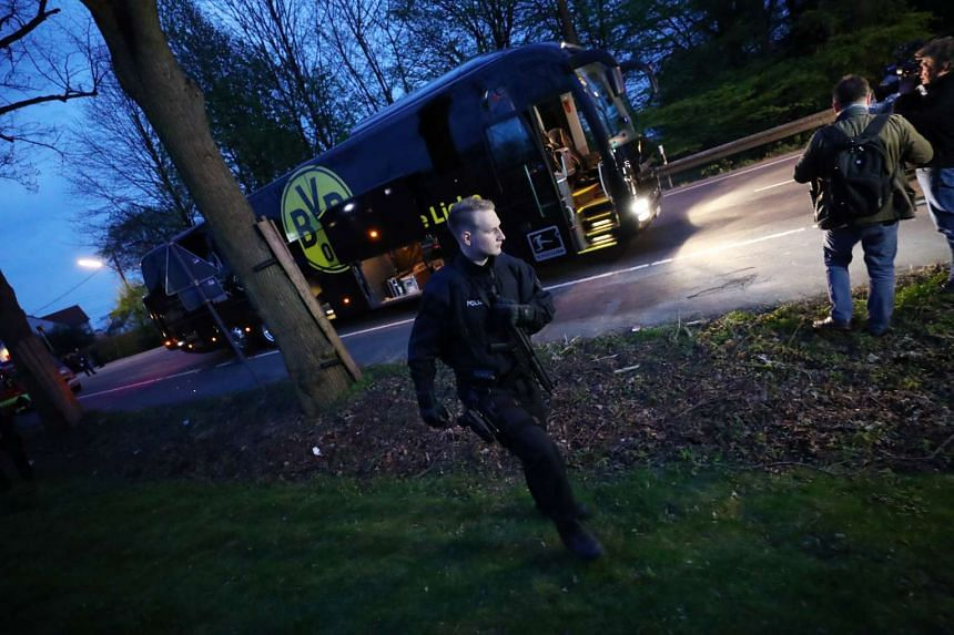 Police with the Borussia Dortmund team bus after the explosion.