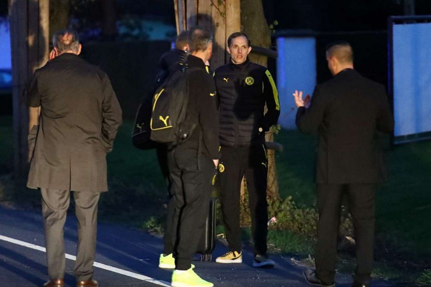 Borussia Dortmund coach Thomas Tuchel is seen by the team bus after the explosion.