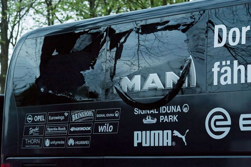 A view of the damaged windows of the Borussia Dortmund's team bus.