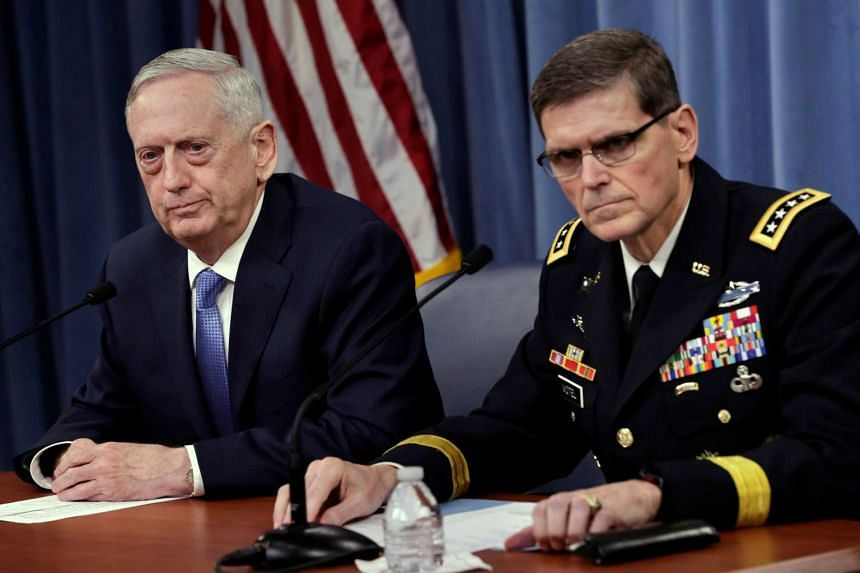 US Defence Secretary James Mattis (left) and Army General Joseph Votel, commander of US Central Command, brief the media.